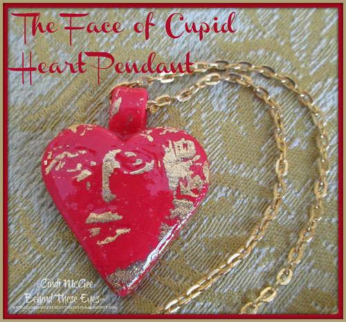 Face of cupid heart pendant
